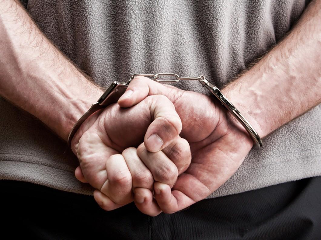 bigstock-Criminal-In-Handcuffs-14611325