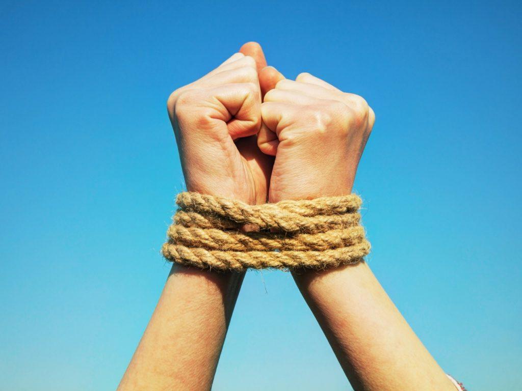 hands-tied-rope-shutterstock_184507361